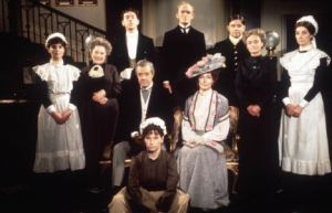 Upstairs Downstairs 1986 David Laangton and Racchel Gurney (Richard and Lady Marjorie Bellamy), centre, with their staff, clockwise from left, Pauline Collins (Sarah), Angela Baddeley (mrs Bridges), George Innes (Alfred), Gordon Jackson (Mr Hudson), Brian Osbourne (Pearce), Patsy Smart (Miss Roberts), Jean Marsh (Rose) Evin Crowley (Emily) REF NO : 61010TV MUST CREDIT : TVTIMES / SCOPEFEATURES.COM FOR EDITORIAL USE ONLY